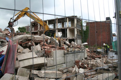 Remnants of Mary Monson Solicitors building (foreground).  Prepping ground for cherrypicker (background).